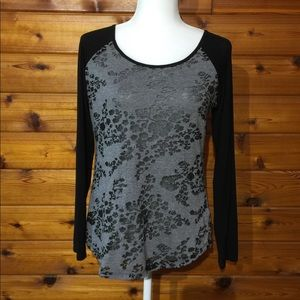 Cute top with sheer burnout print.